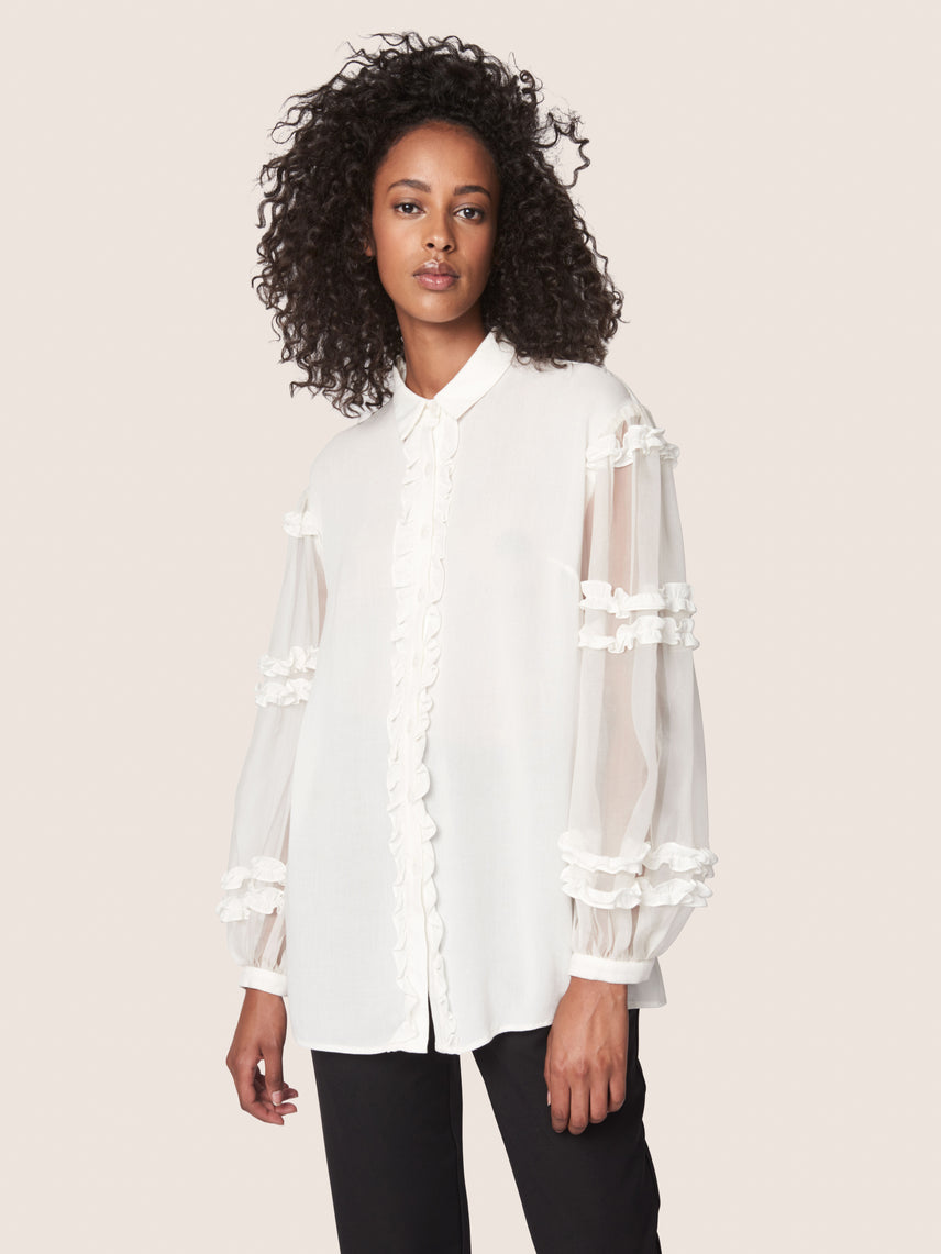 Sheer blouse with ruffled bishop sleeves and ruffled front button closure Alternate