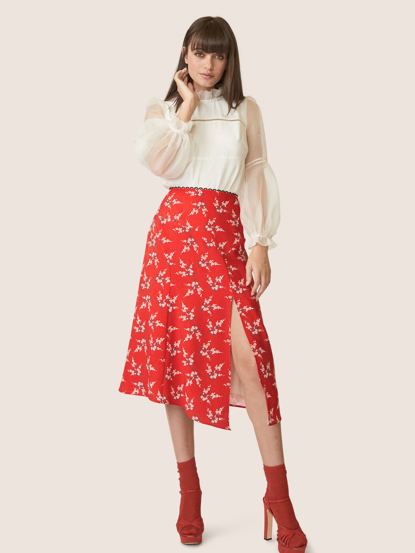 Front view of high waisted floral skirt with slit.