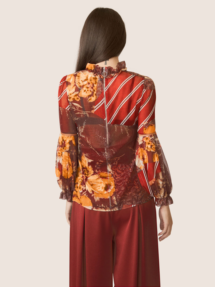 Back view of mixed floral printed ruffle mock neck blouse with billow sleeves Alternate