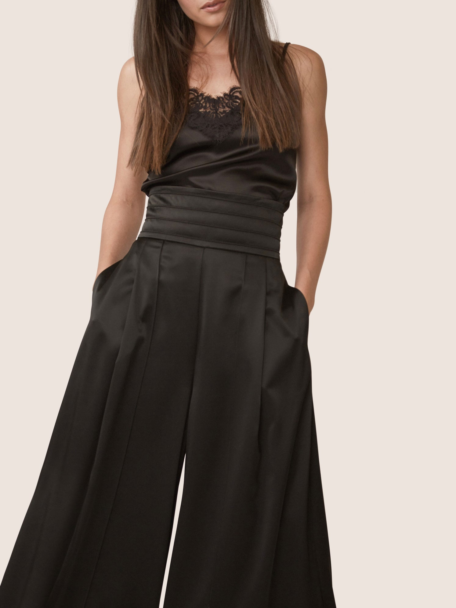 High waistline of black satin wide leg pant with front slit Alternate