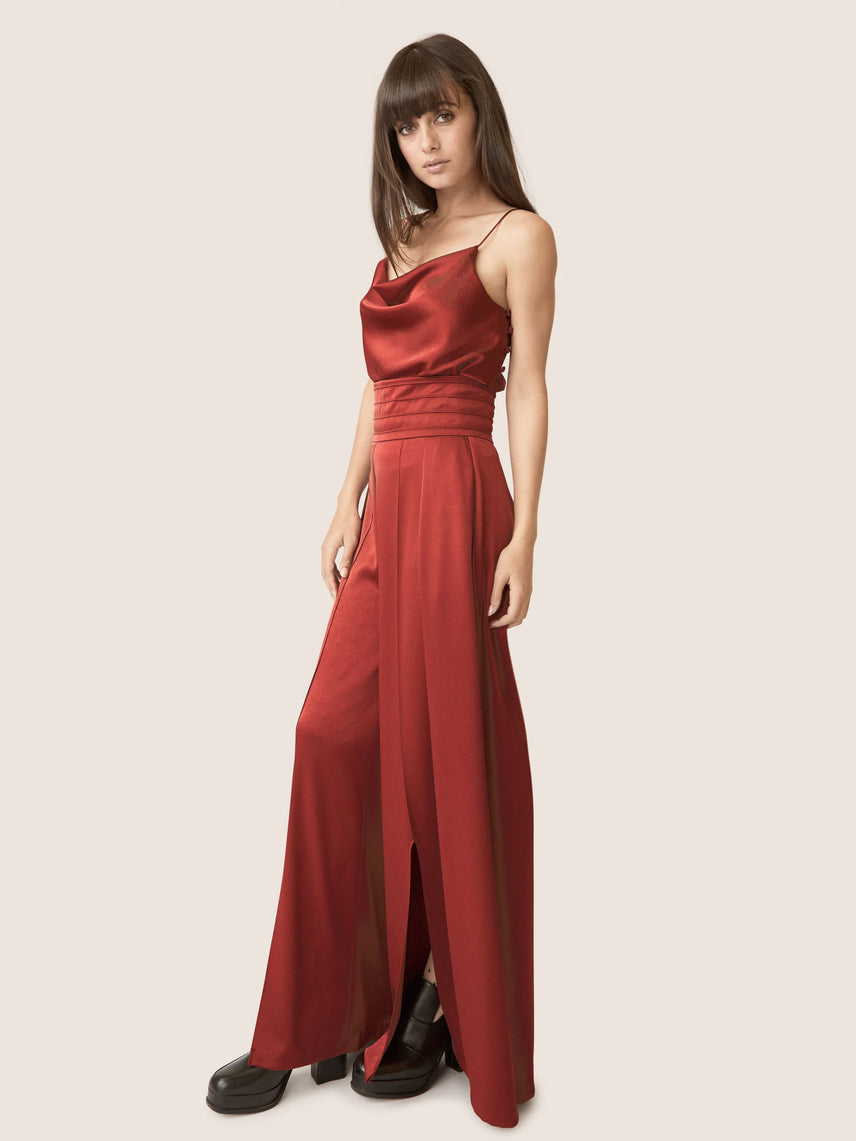 Side view of contemporary rust satin wide leg pants with ultra-high waistline and front slit Alternate