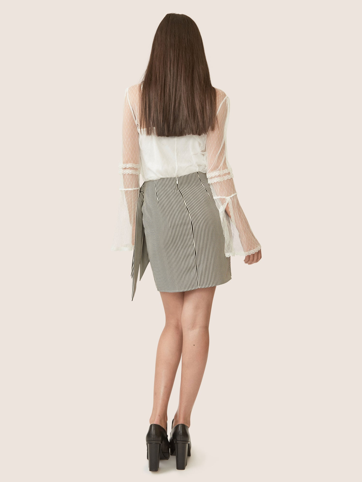 Back view of striped matte satin side knot skirt with drape
