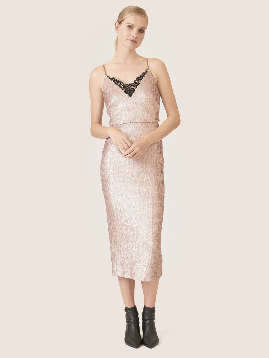 Matte sequin cocktail dress with v-neckline and lace detail.