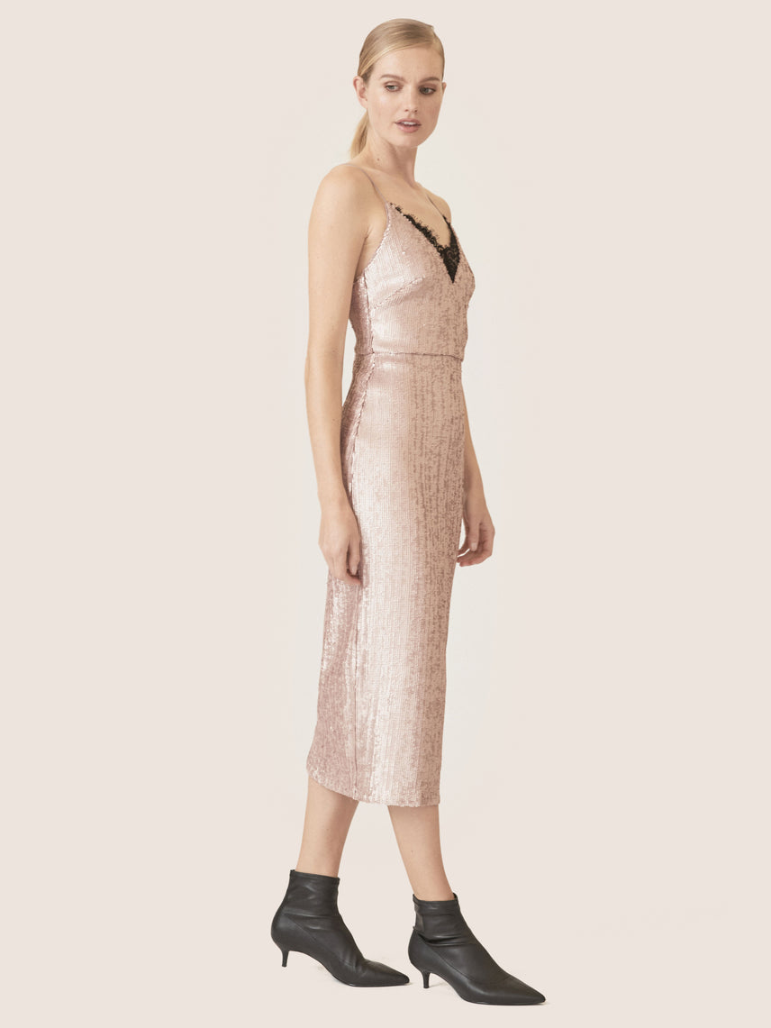 Side view of matte sequin cocktail dress with v-neckline and lace detail.