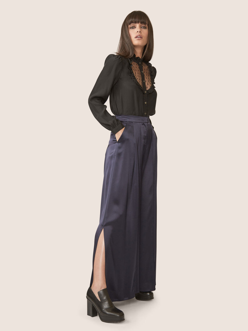 Side view of high waisted satin wide leg pants with side slits and pockets Alternate