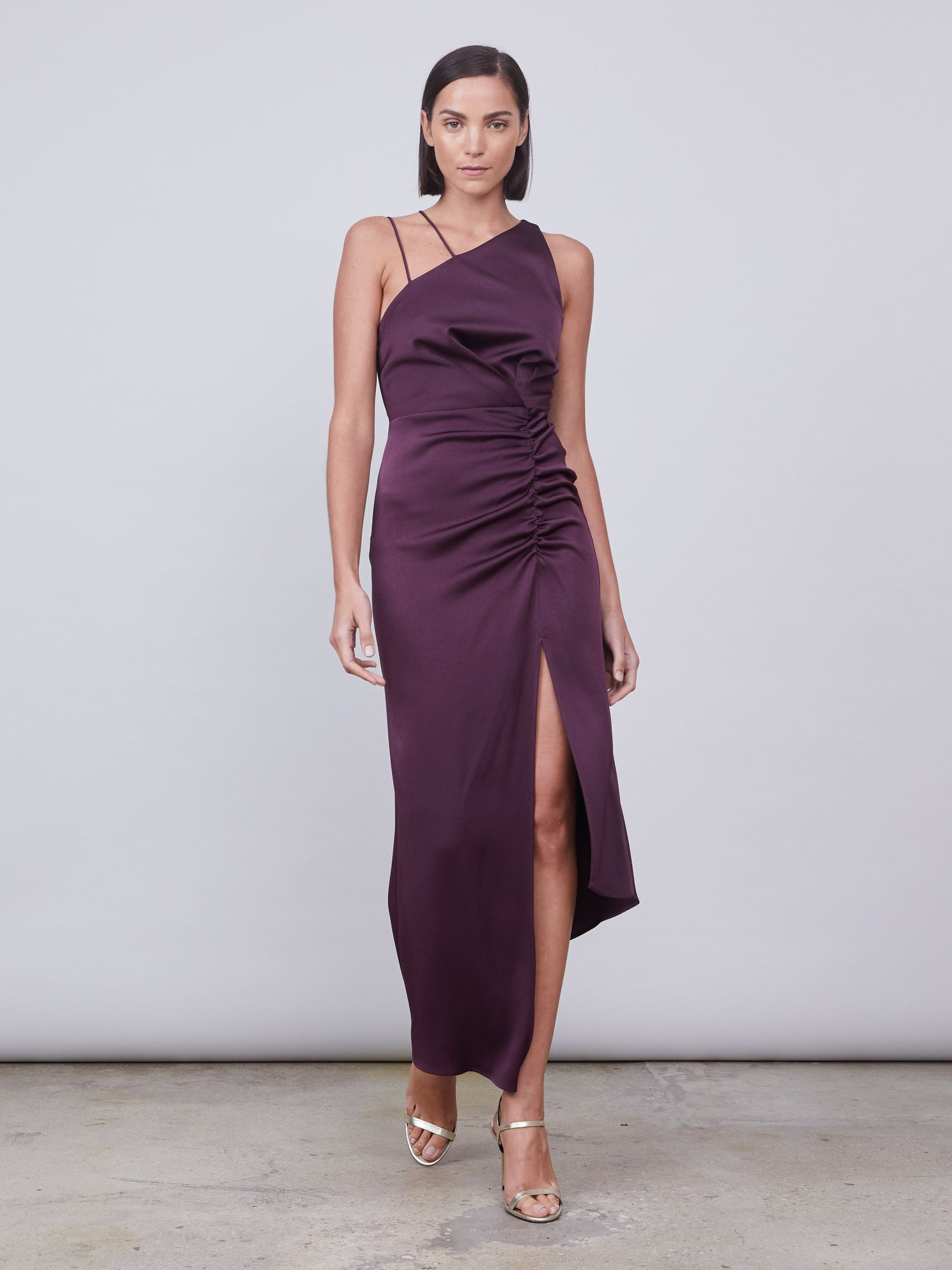 One shoulder neckline and double spaghetti strap asymmetrical dress with front slit