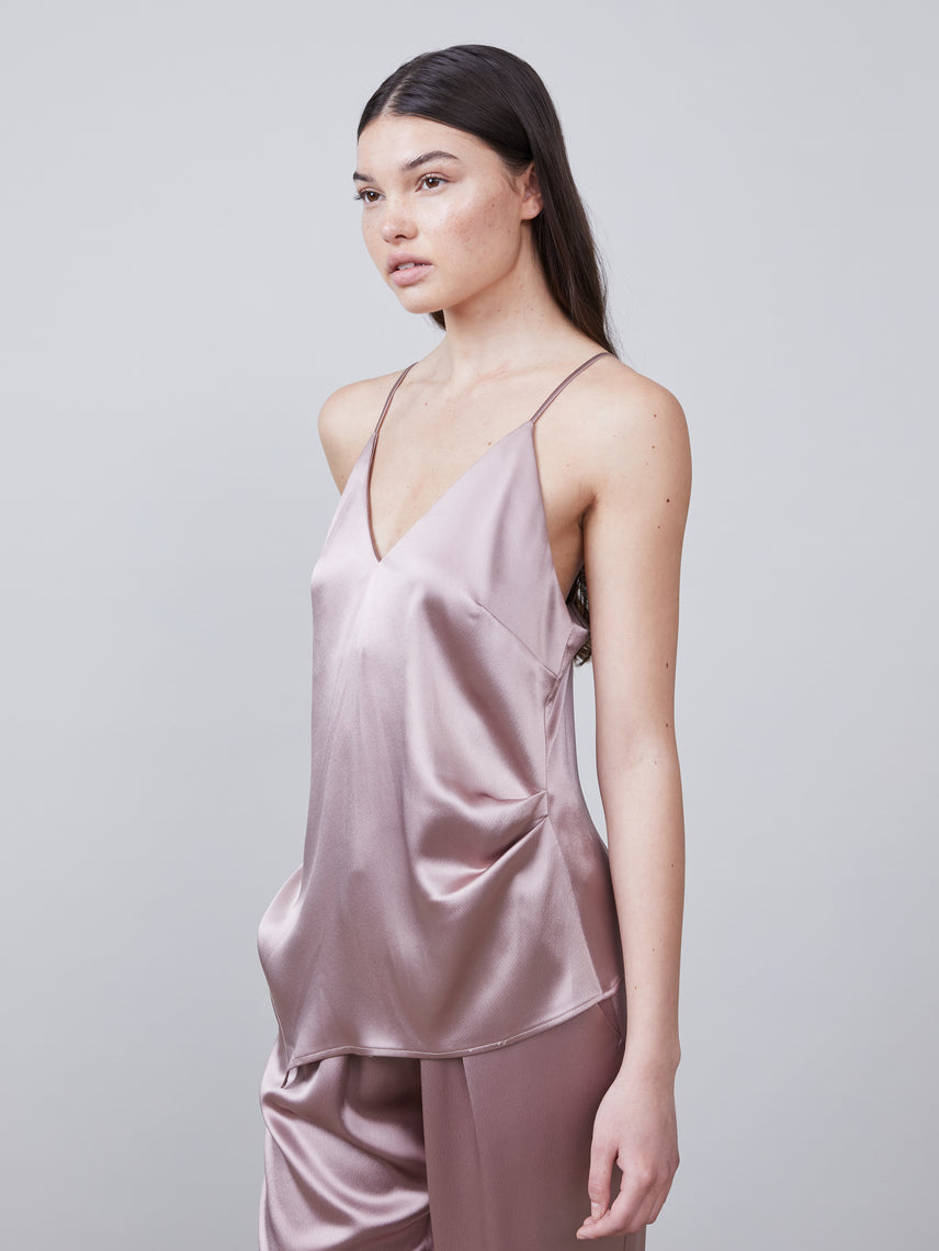 3/4 view of the Alannah Deep-V Sustainable Satin Cami featuring an asymmetrical hemline and side pleats in mink