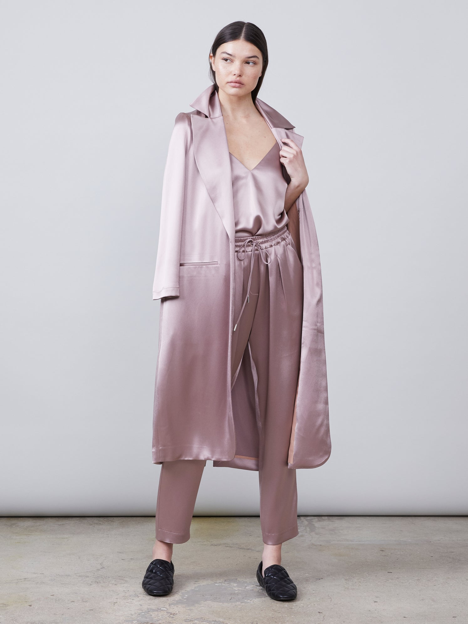 Full body view of the Alannah Deep-V Sustainable Satin Cami paired with the matching Trinity Sustainable Satin Track Pant and Carmen Sustainable Satin Jacket in mink