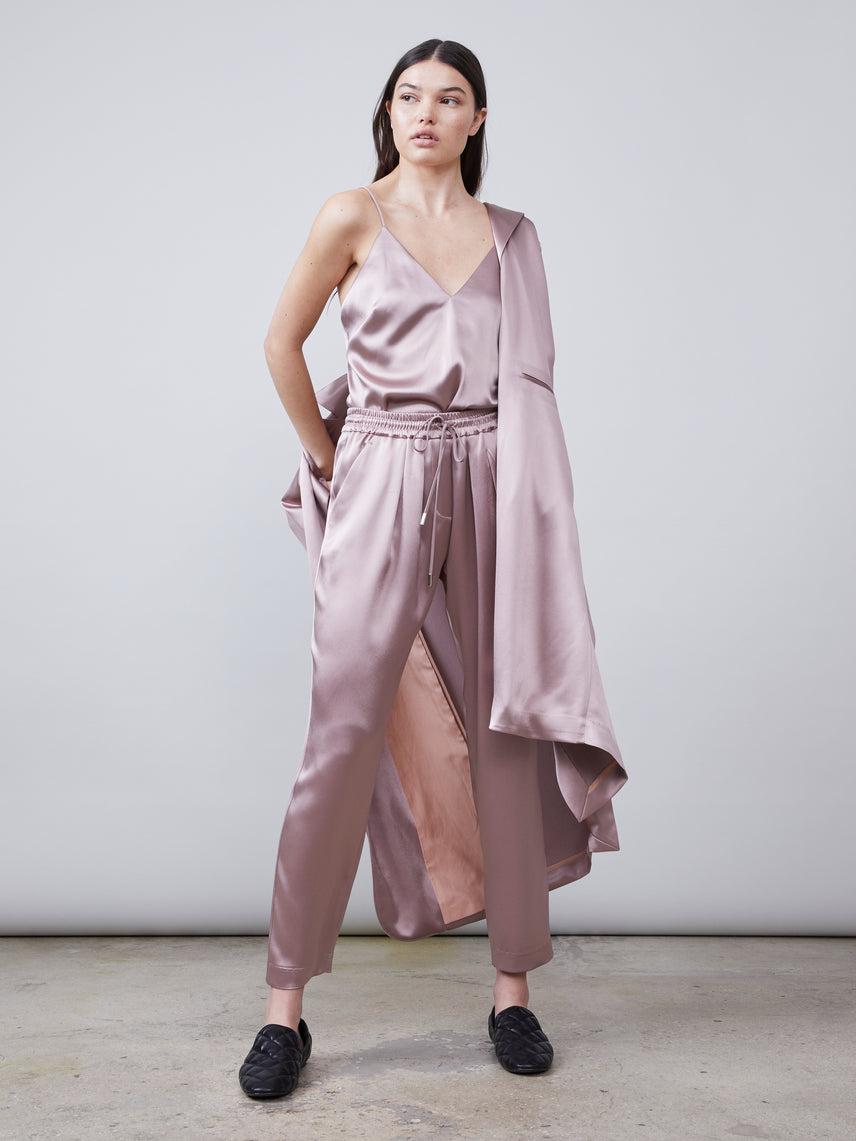 Full body view of the Alannah Deep-V Sustainable Satin Cami paired with the matching Trinity Sustainable Satin Track Pant and Carmen Sustainable Satin Jacket in mink Alternate