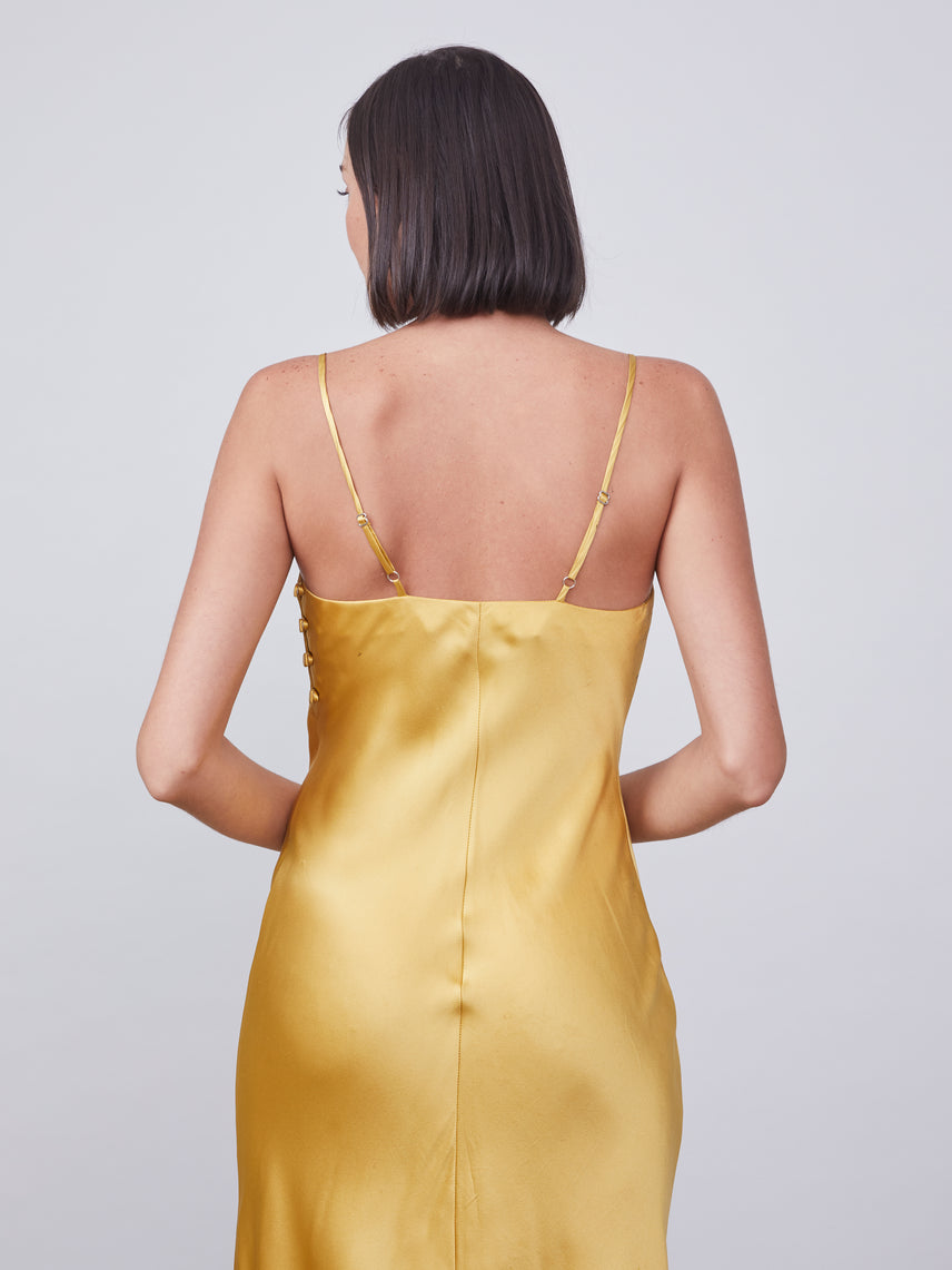 Silk slip dress in gold
