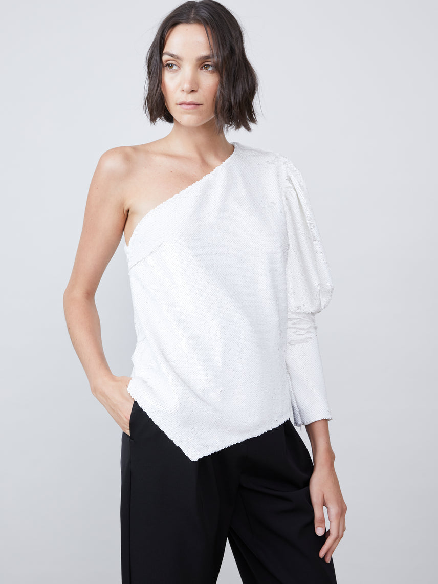 One shoulder puff sleeve sequin blouse with an asymmetrical hemline