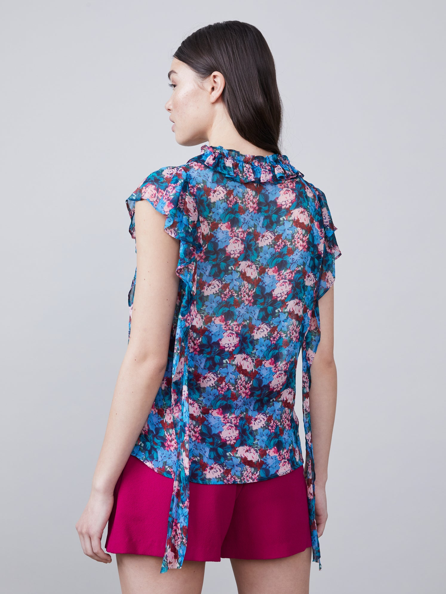 Floral print cascade ruffled blouse