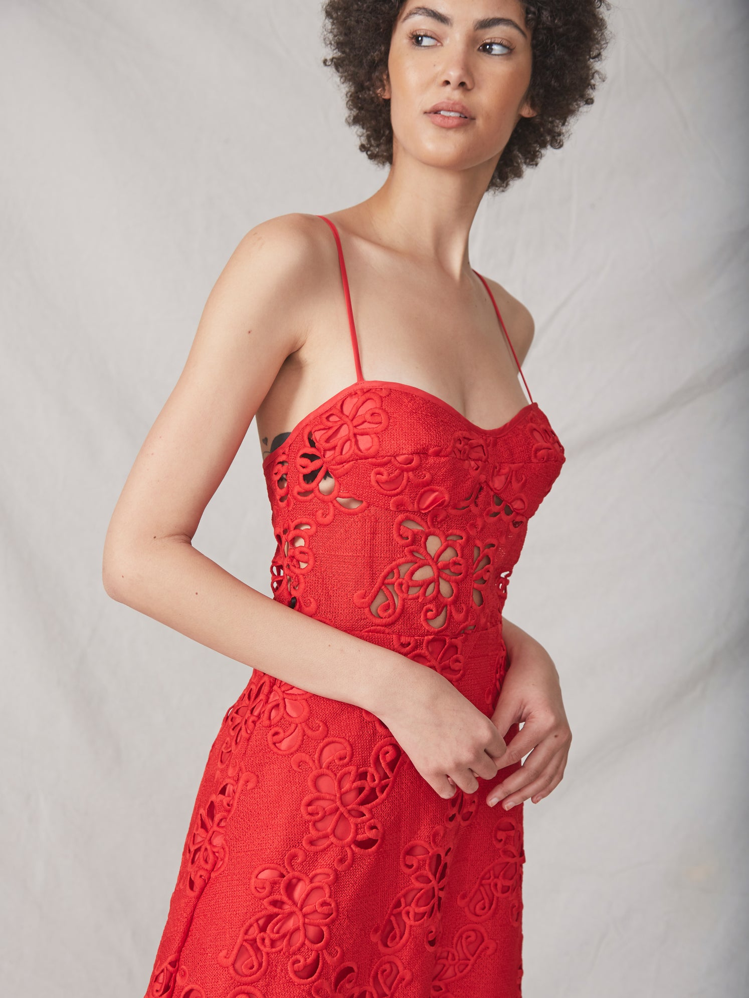 Red embroidered lace midi bustier dress with semi-sheer bodice and side pockets