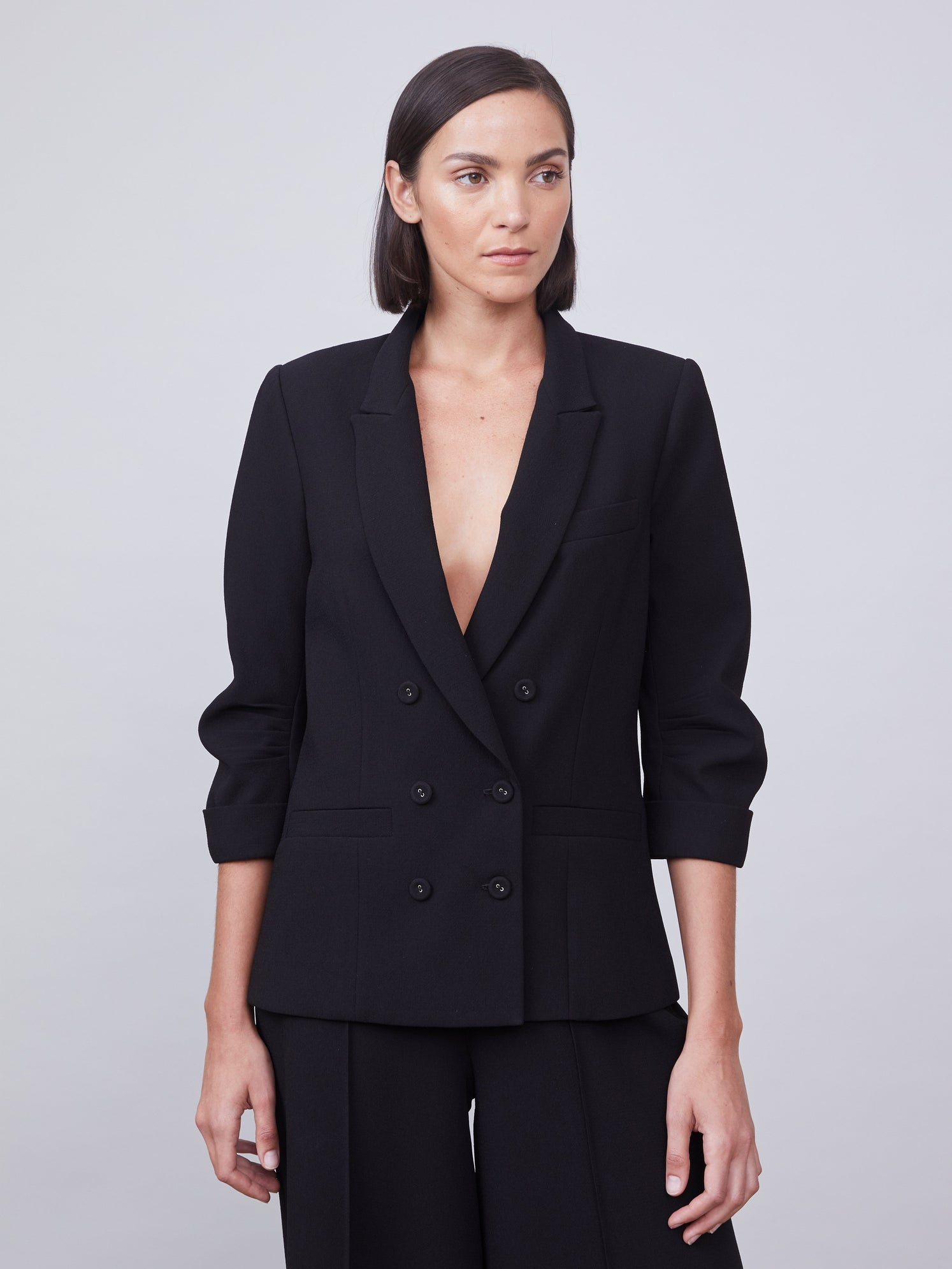 Double breasted blazer featuring ruched 3/4 sleeves