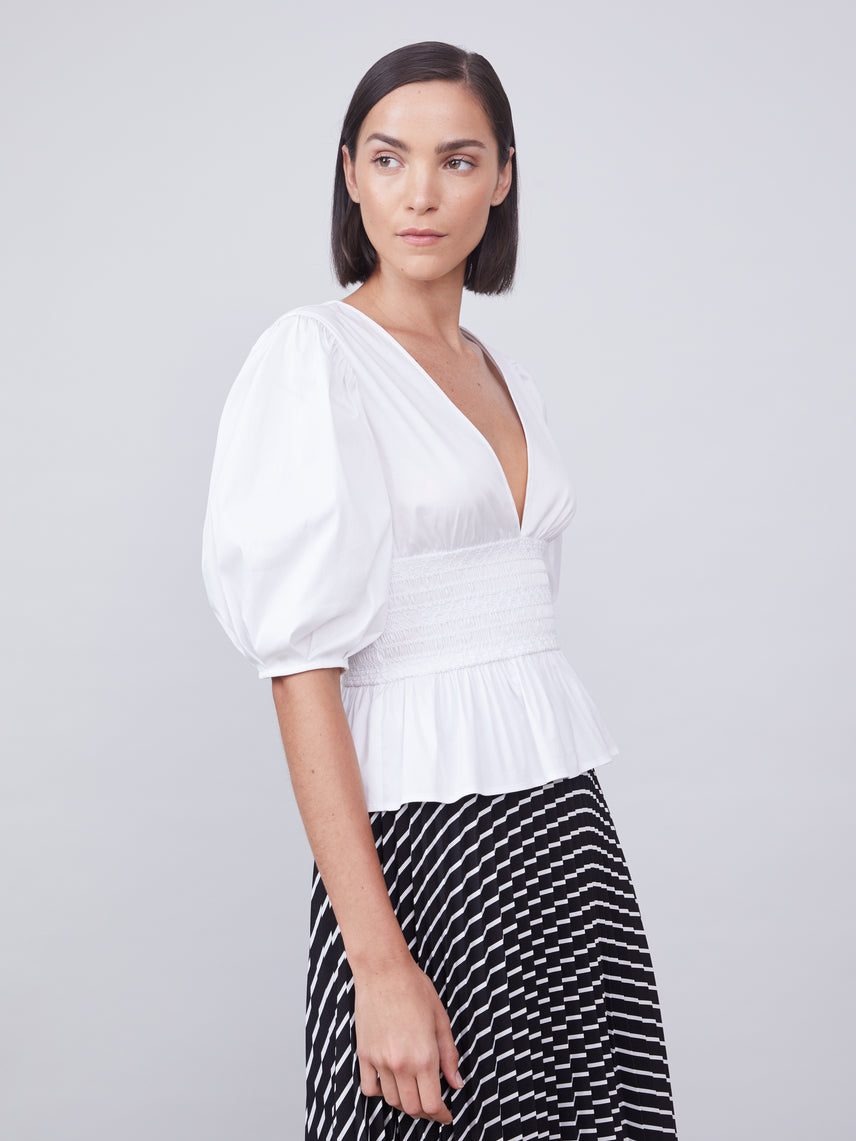 Deep-V white blouse with ruched smocked waist and puff sleeves
