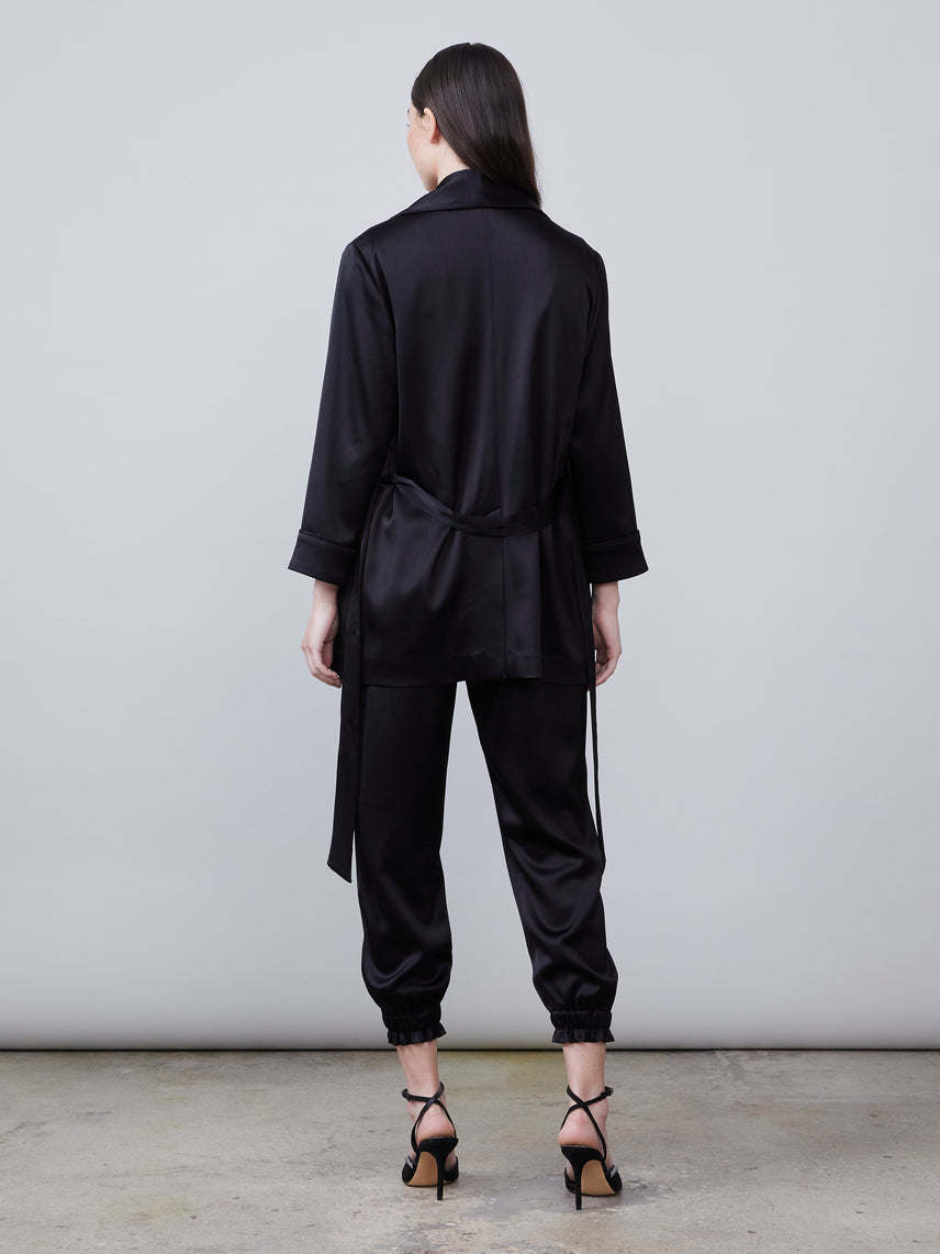 Back full body view of Harper Satin Jacket with front tie and Trinity Satin Pant in black