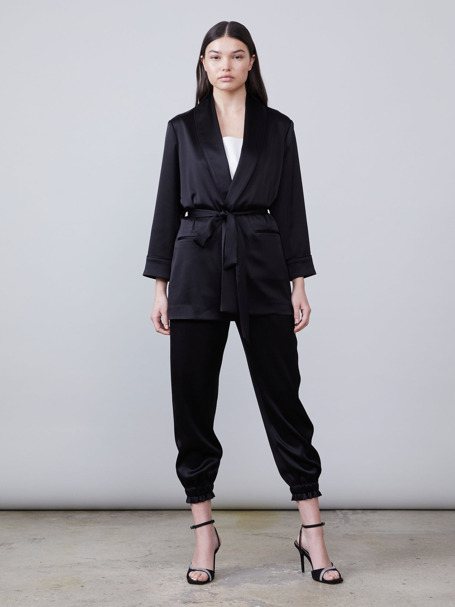 Front full body view of Harper Satin Jacket tied and Trinity Satin Pant in black