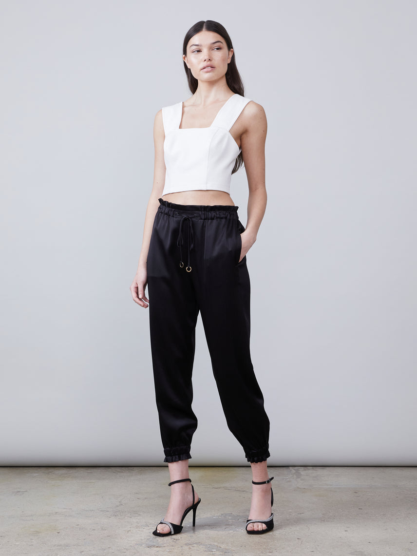 Front view of the Trinity Sustainable Satin Track Pant in black