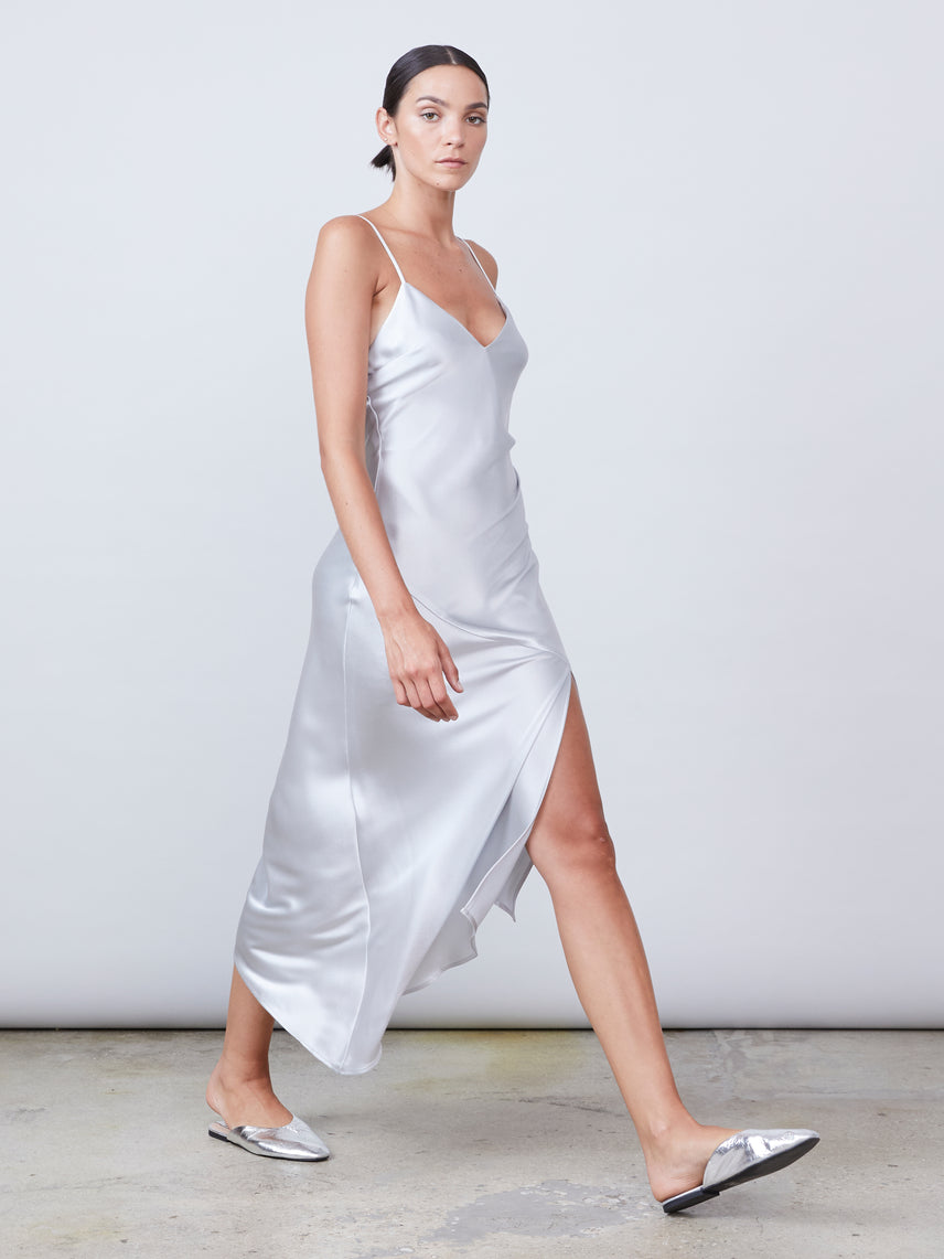 Satin asymmetrical slip dress with deep v-neckline and front slit