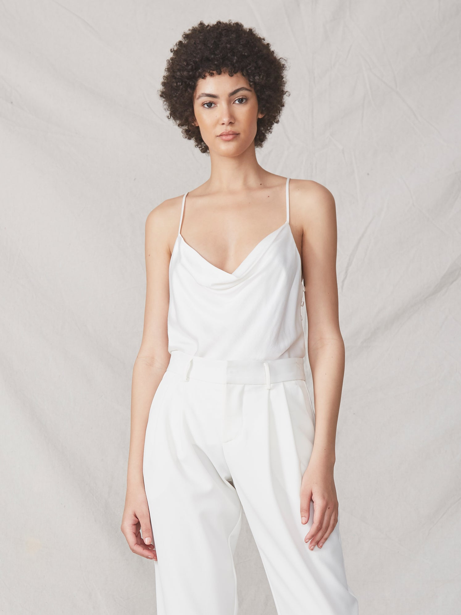 Ivory cowl neckline cami with spaghetti straps and side buttons