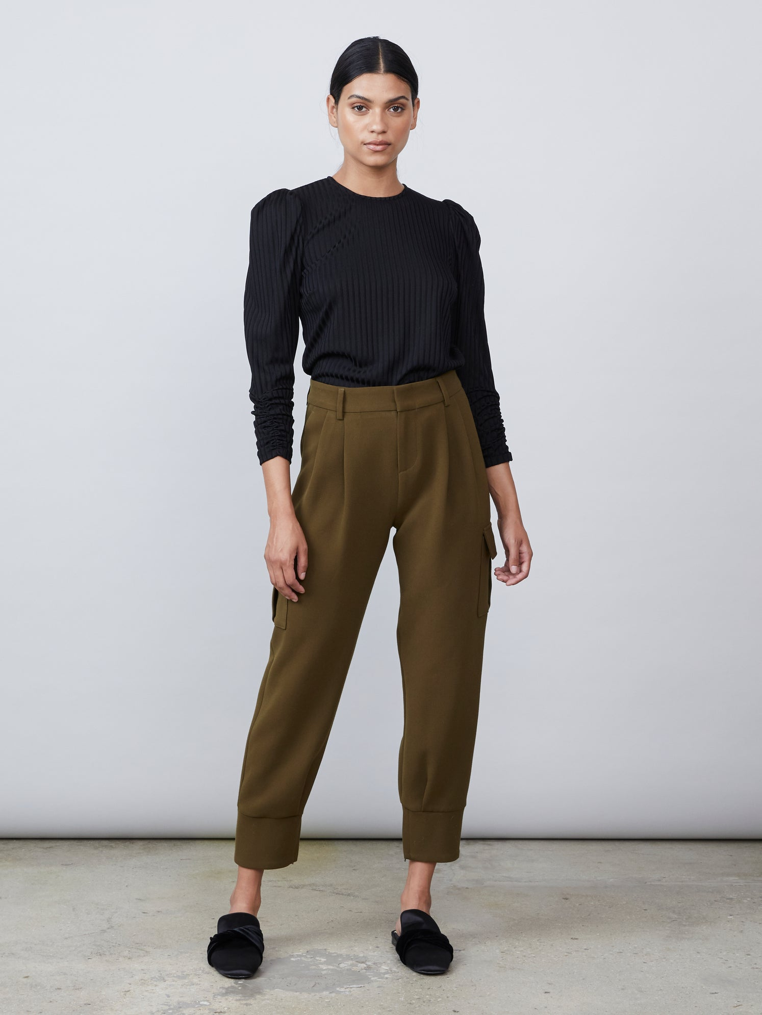 Woven cargo pant with lower side pockets and cuffed hem