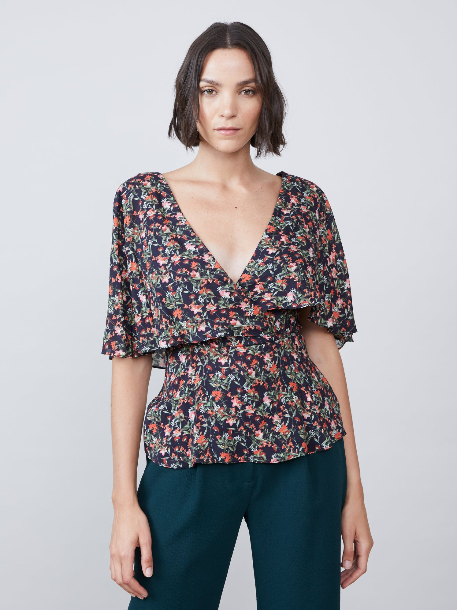 Floral print exposed cross tie back cinched waist ruched sleeves capelet top