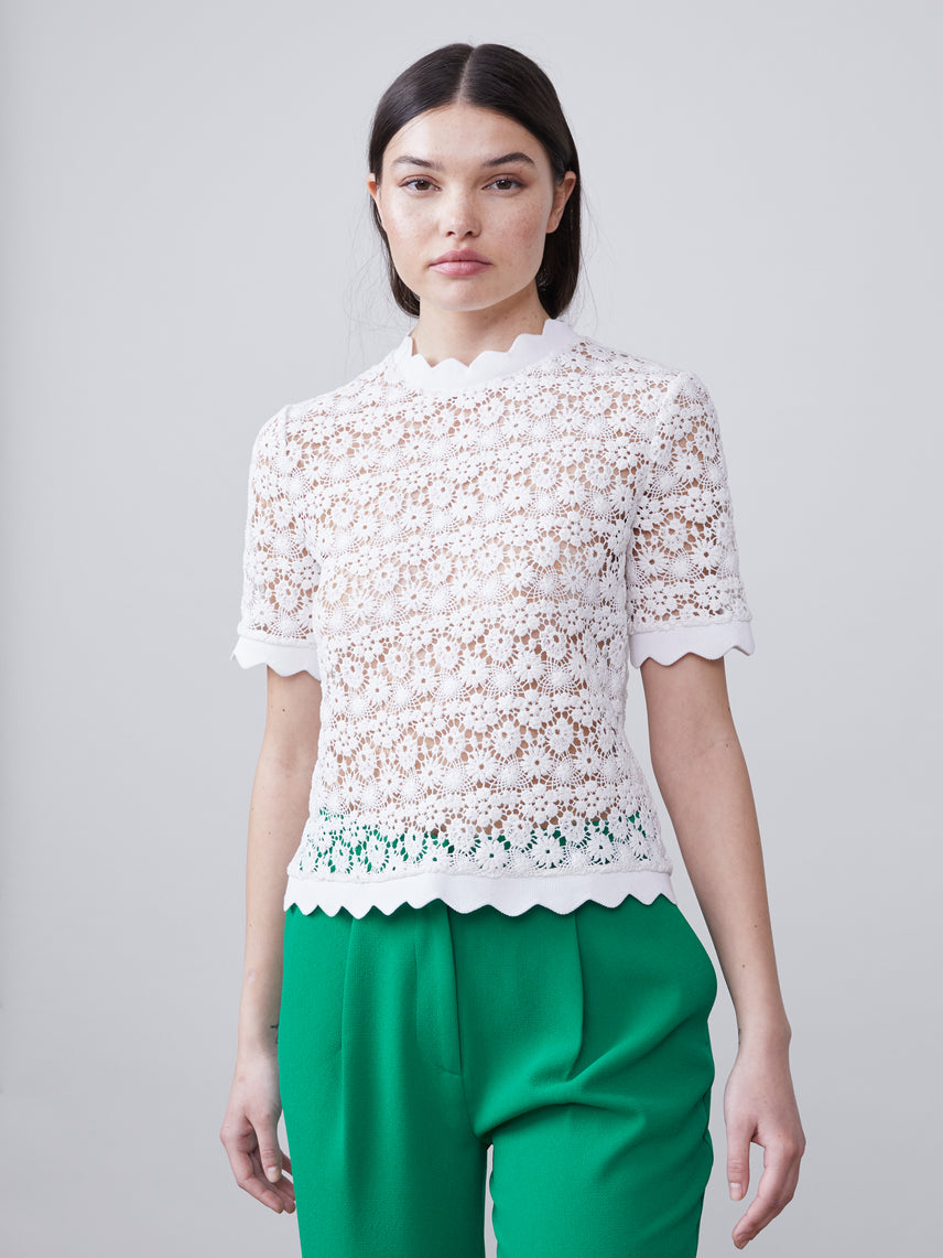 Front view of the Off white scalloped Lilly Blouse with short sleeves