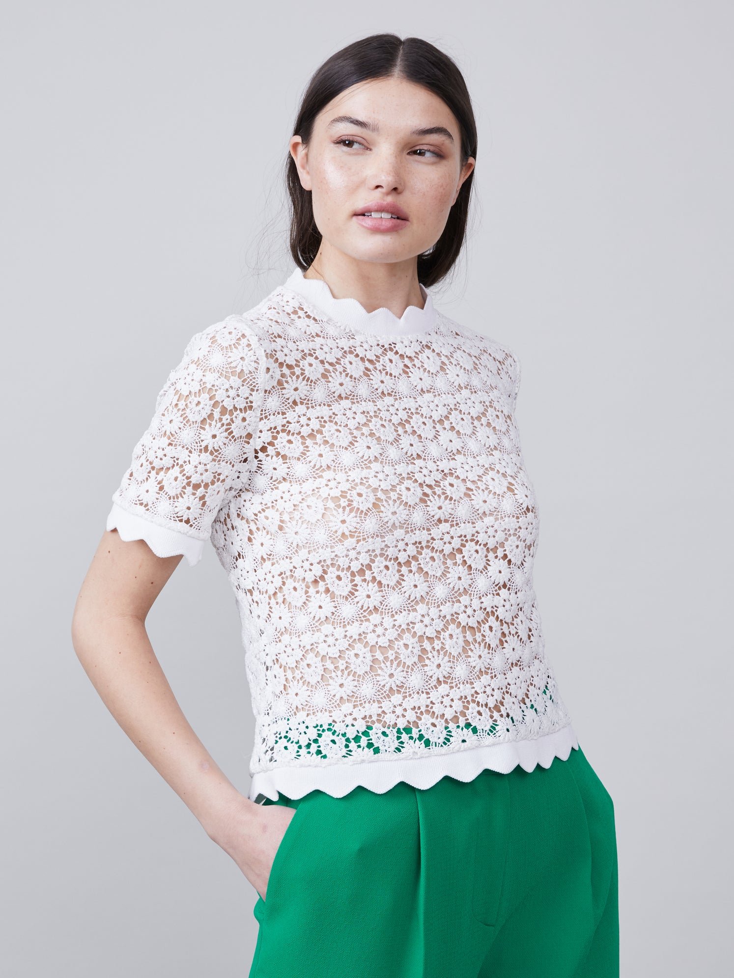 3/4 view of the Off white scalloped Lilly Blouse with short sleeves