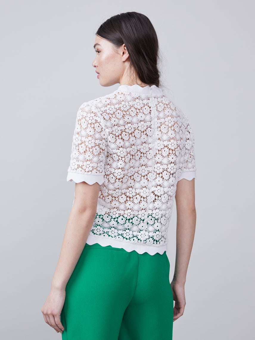 Back view of the Off white scalloped Lilly Blouse with short sleeves
