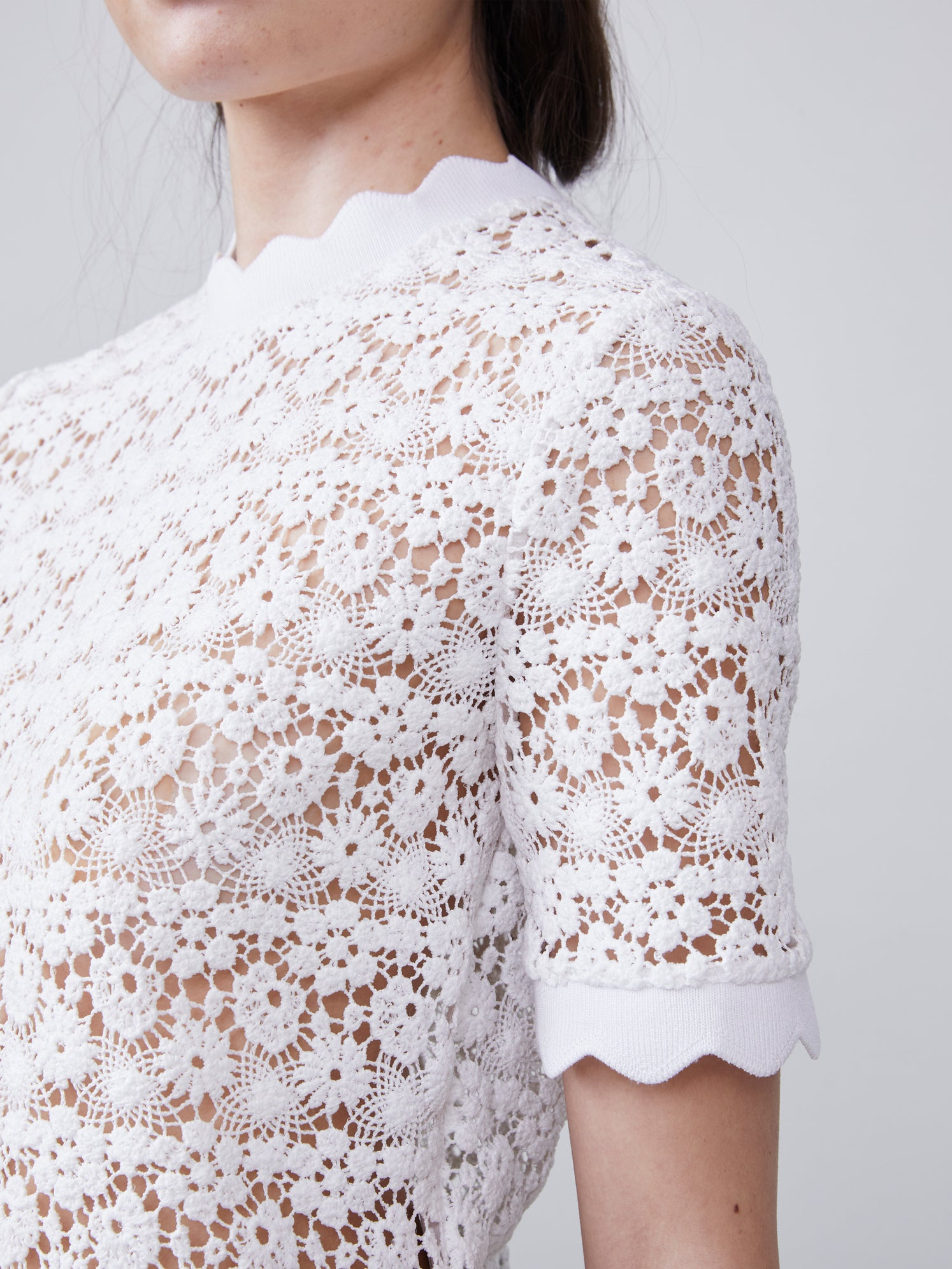 Close up view of the Off white scalloped sleeve of the Lilly Blouse Alternate