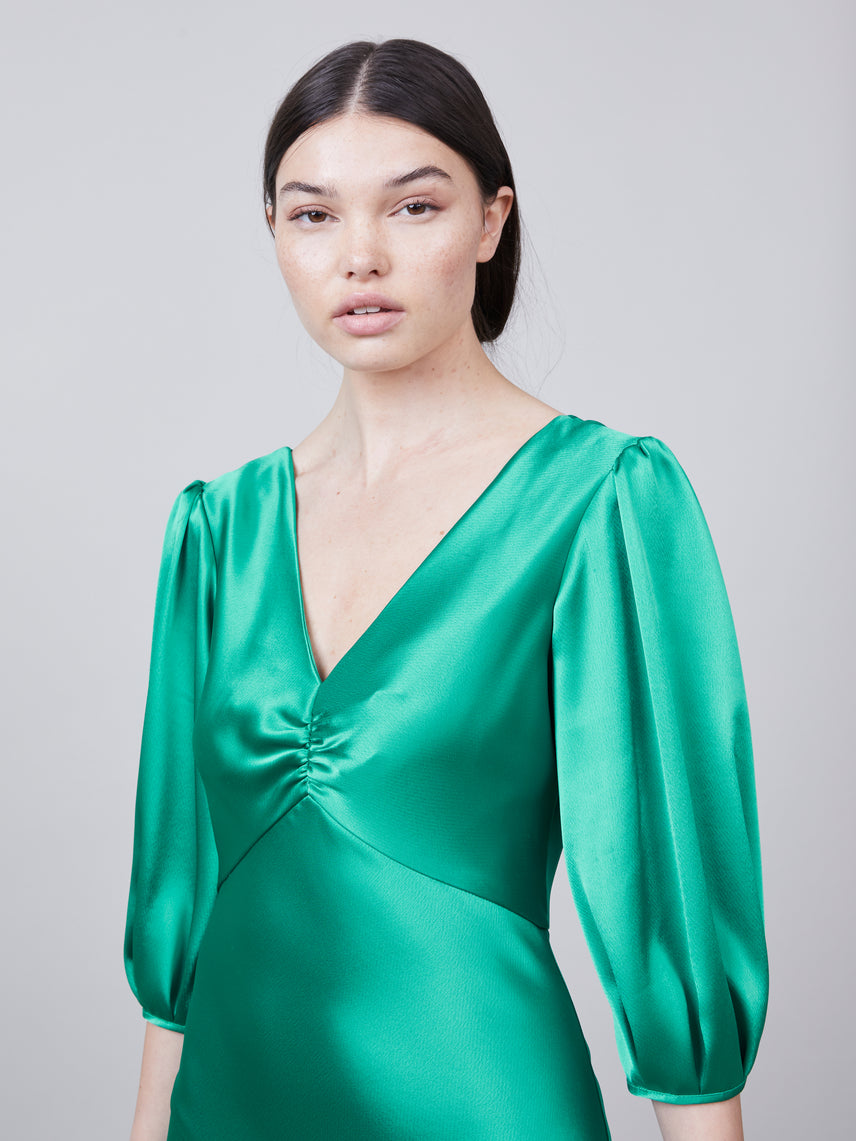 Close up view of deep-v on the Louise Dress in jade Alternate