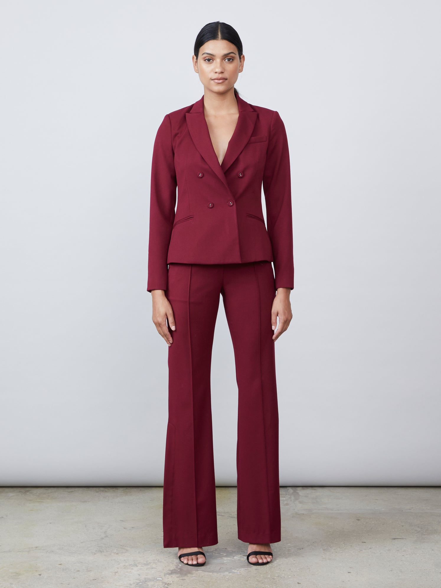Gabardine skinny flared pants with leg slit