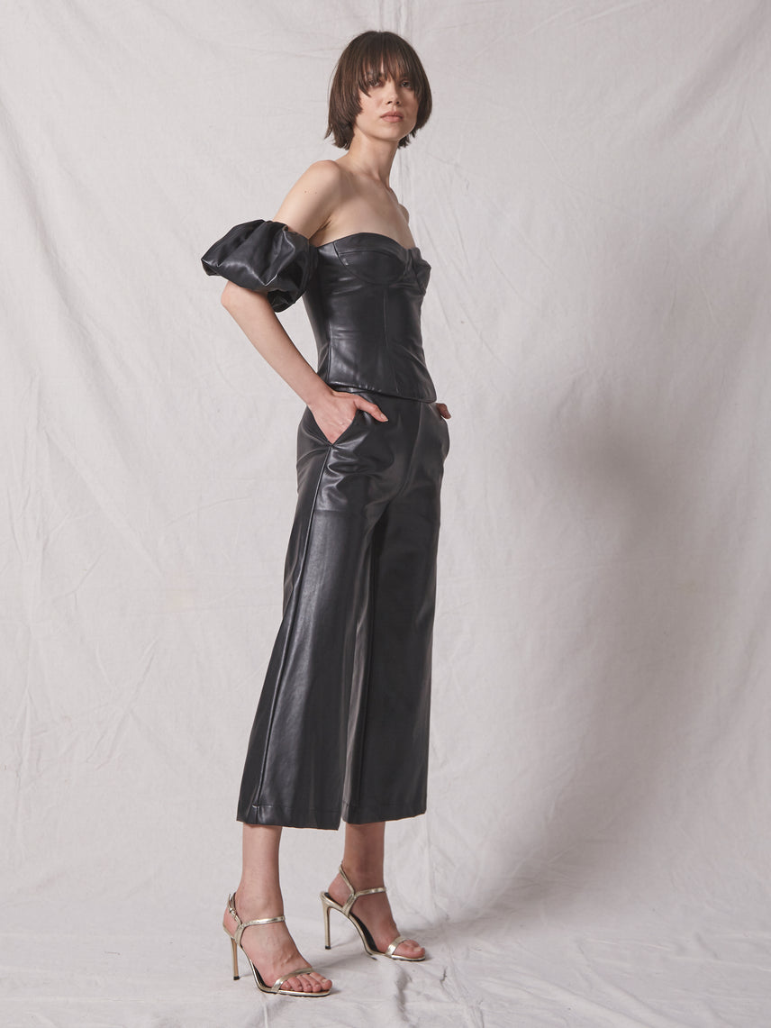 Cropped vegan leather pant with bottom flare and matching off shoulder top