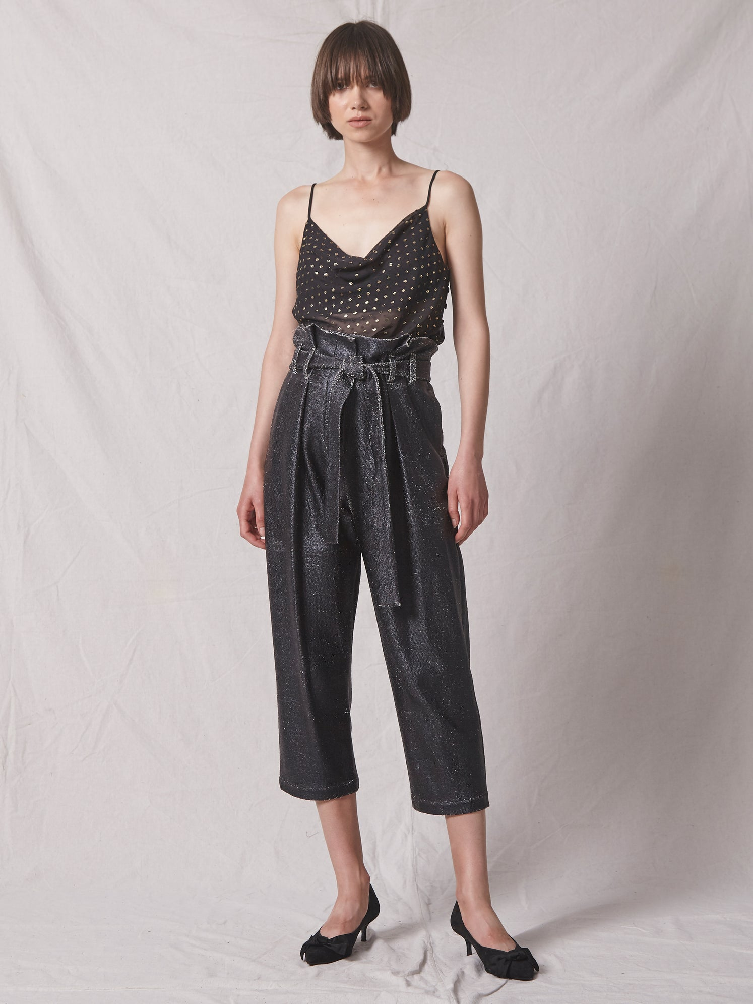 High-rise foiled knit jersey cropped pant with paperbag waist and drapey tie belt