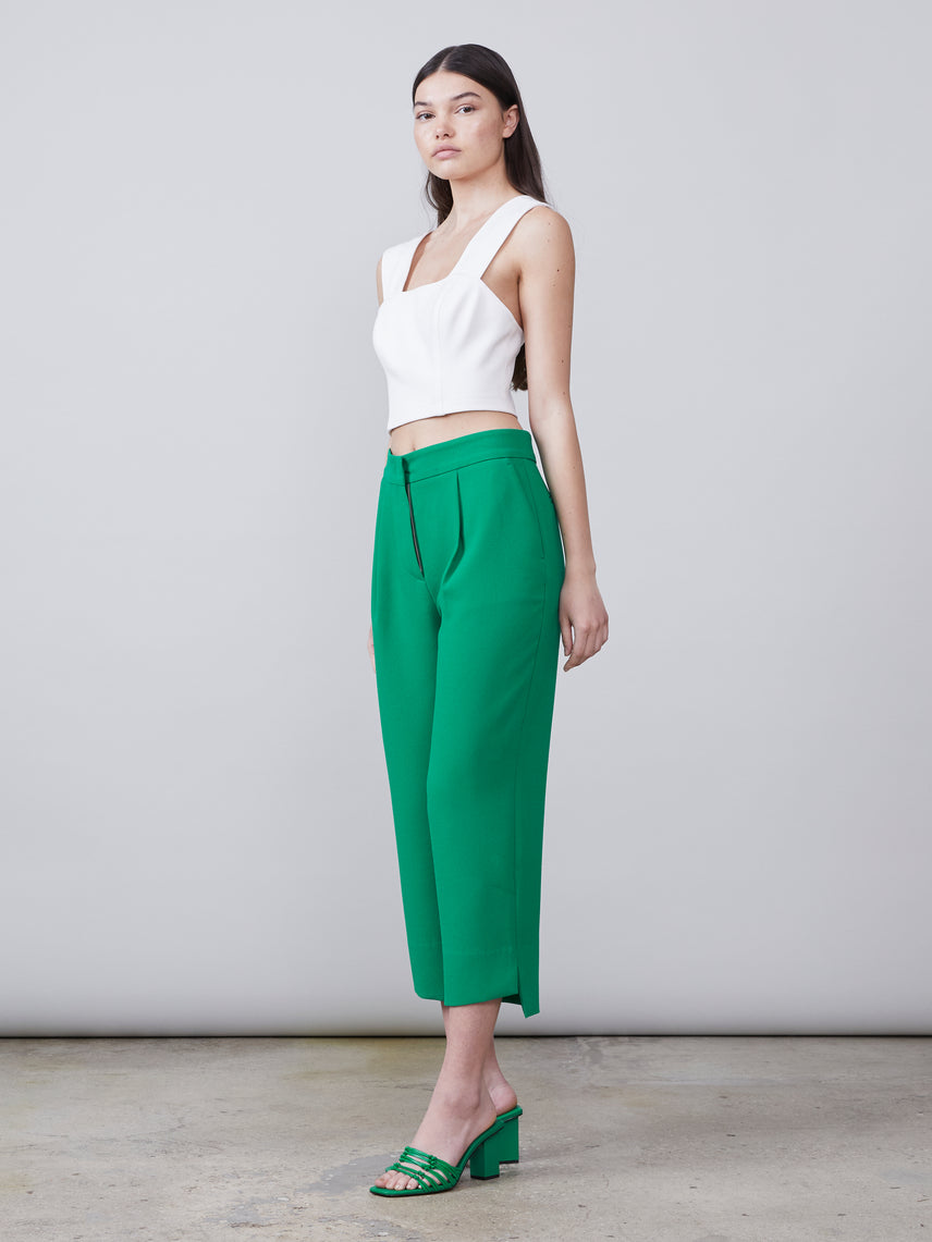 Side view of the cropped pleated Tracy Pant in kelly green paired with the Ren Crop Top