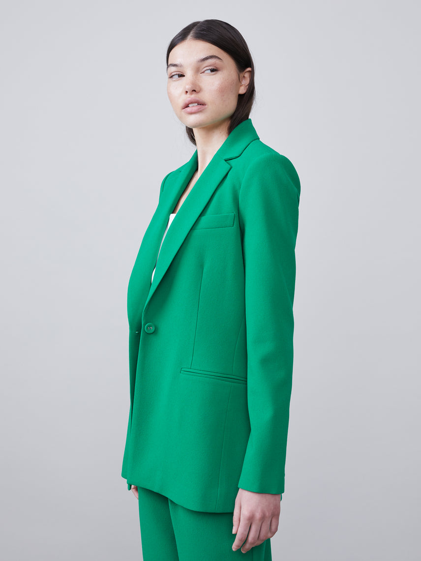 Side unbuttoned view of the Nissa Blazer in kelly green