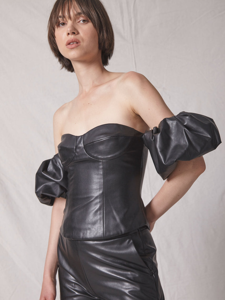 Off shoulder bustier top in vegan leather with puff sleeves