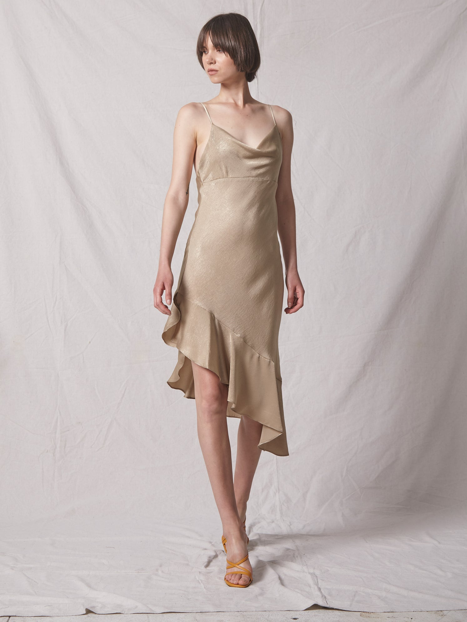 Crushed satin midi dress with cowl neckline and asymmetrical ruffle hem