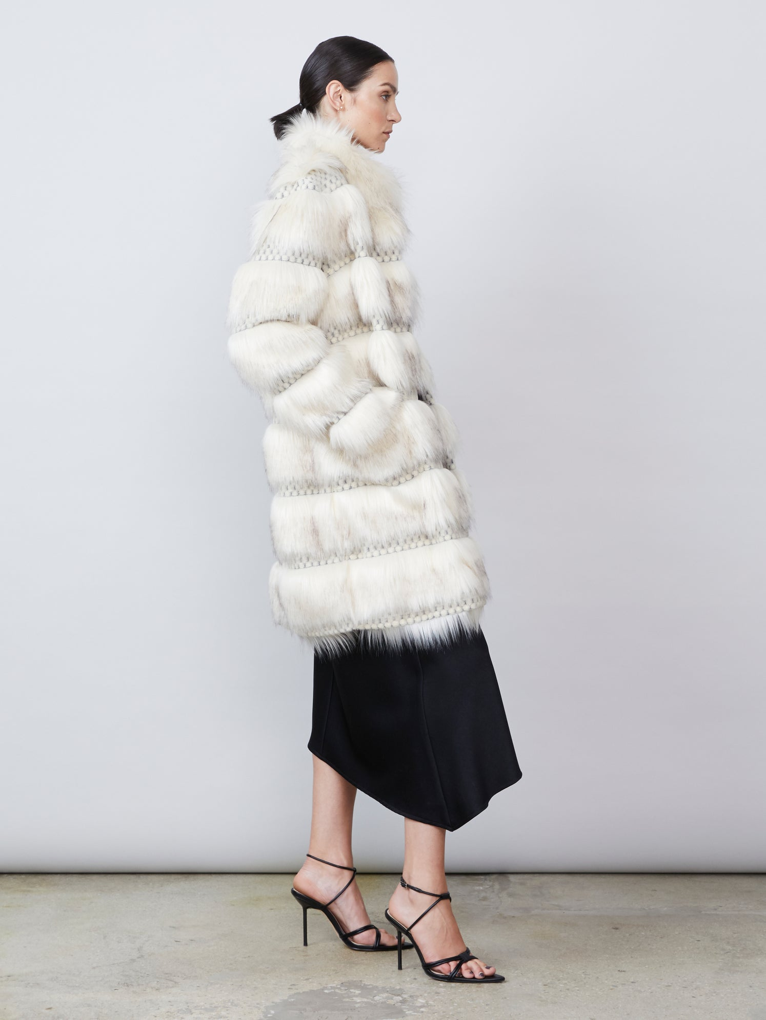 Ivory paneled faux fur coat