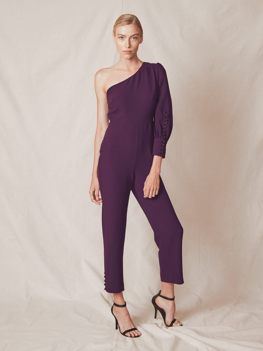 One shoulder jumpsuit with single sleeve button detail and a slightly flared leg