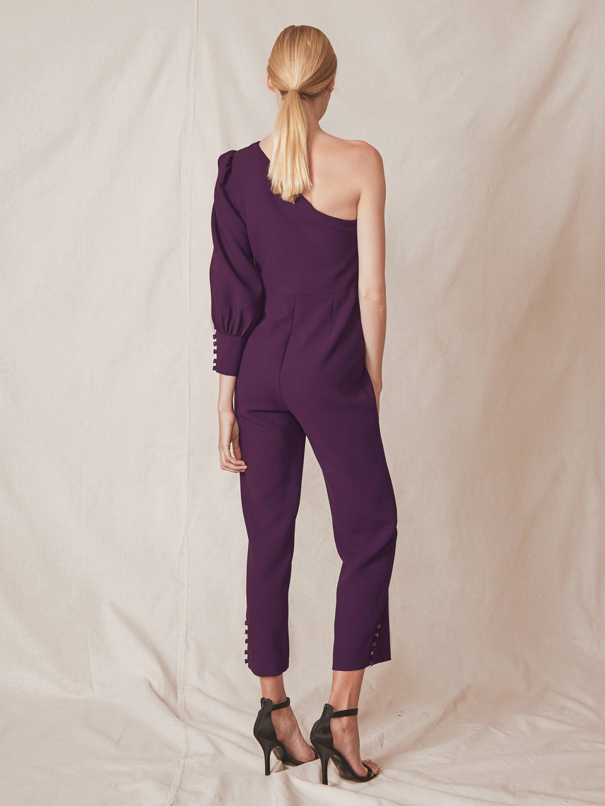 One shoulder jumpsuit with single sleeve button detail and a slightly flared leg Alternate