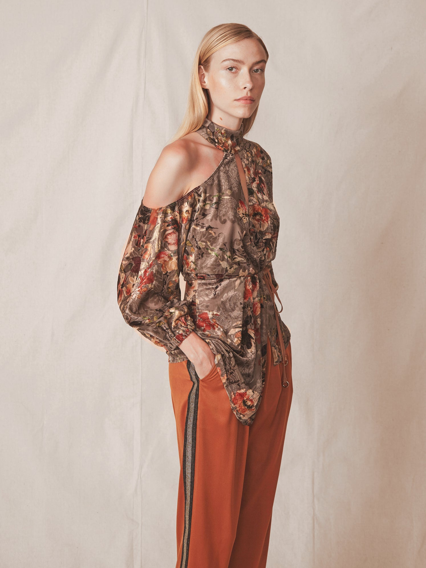 Floral velvet wrap top with cutout shoulder and mock neck