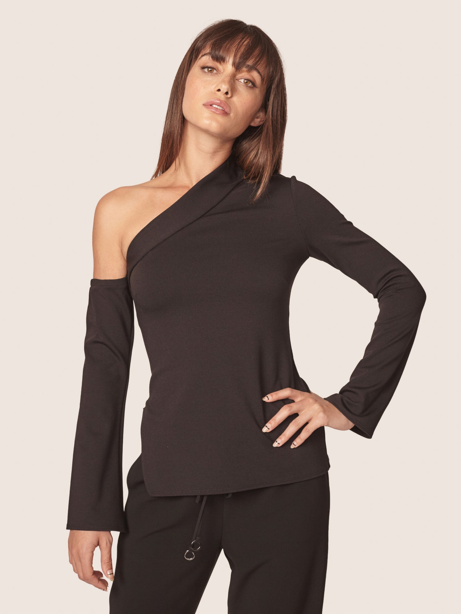 Black one shoulder top with sleeves and side zipper slit