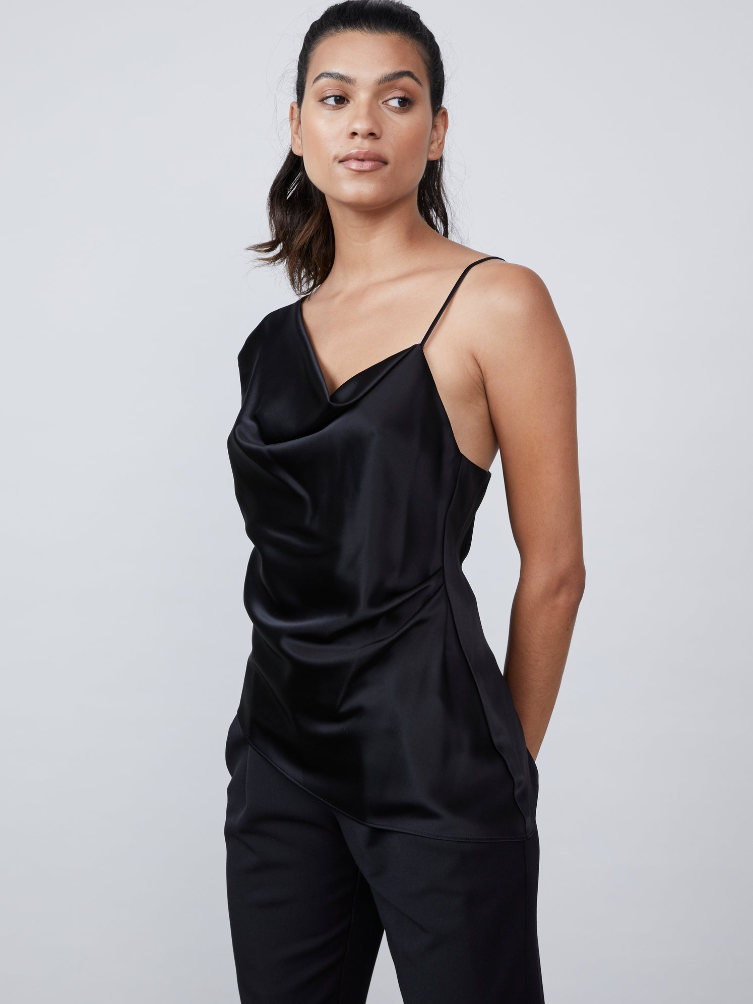 Black crepe satin one shoulder top with asymmetrical hemline and cowl neckline