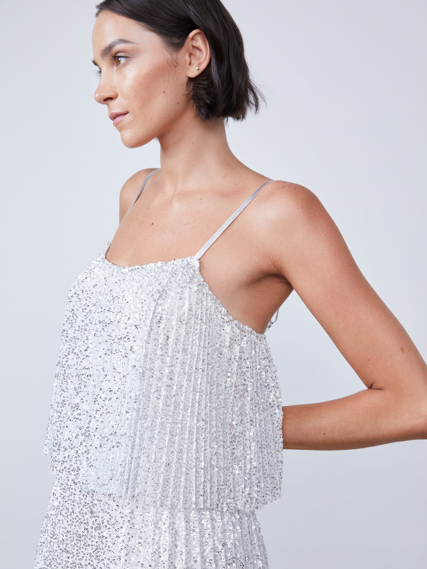 Pleated sequin cami with open back and a high low hem
