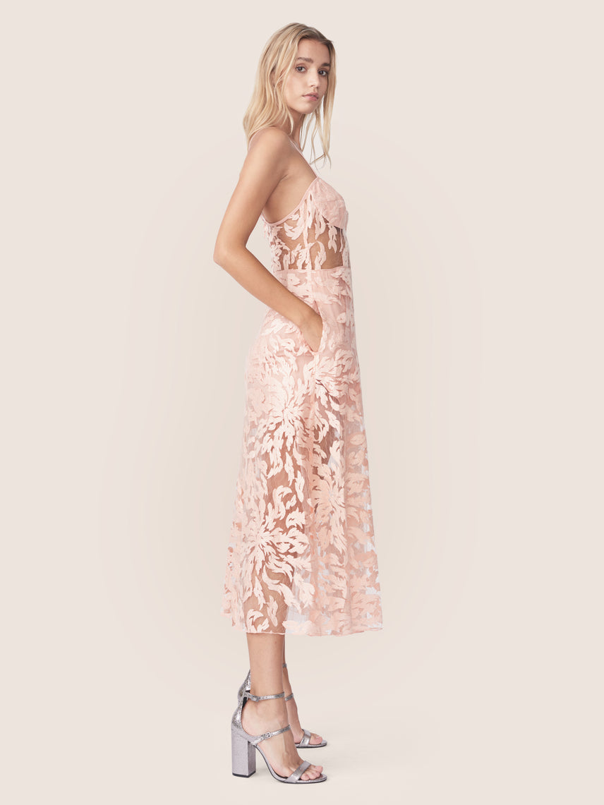 Side view of apricot embroidered lace bustier dress with side pockets