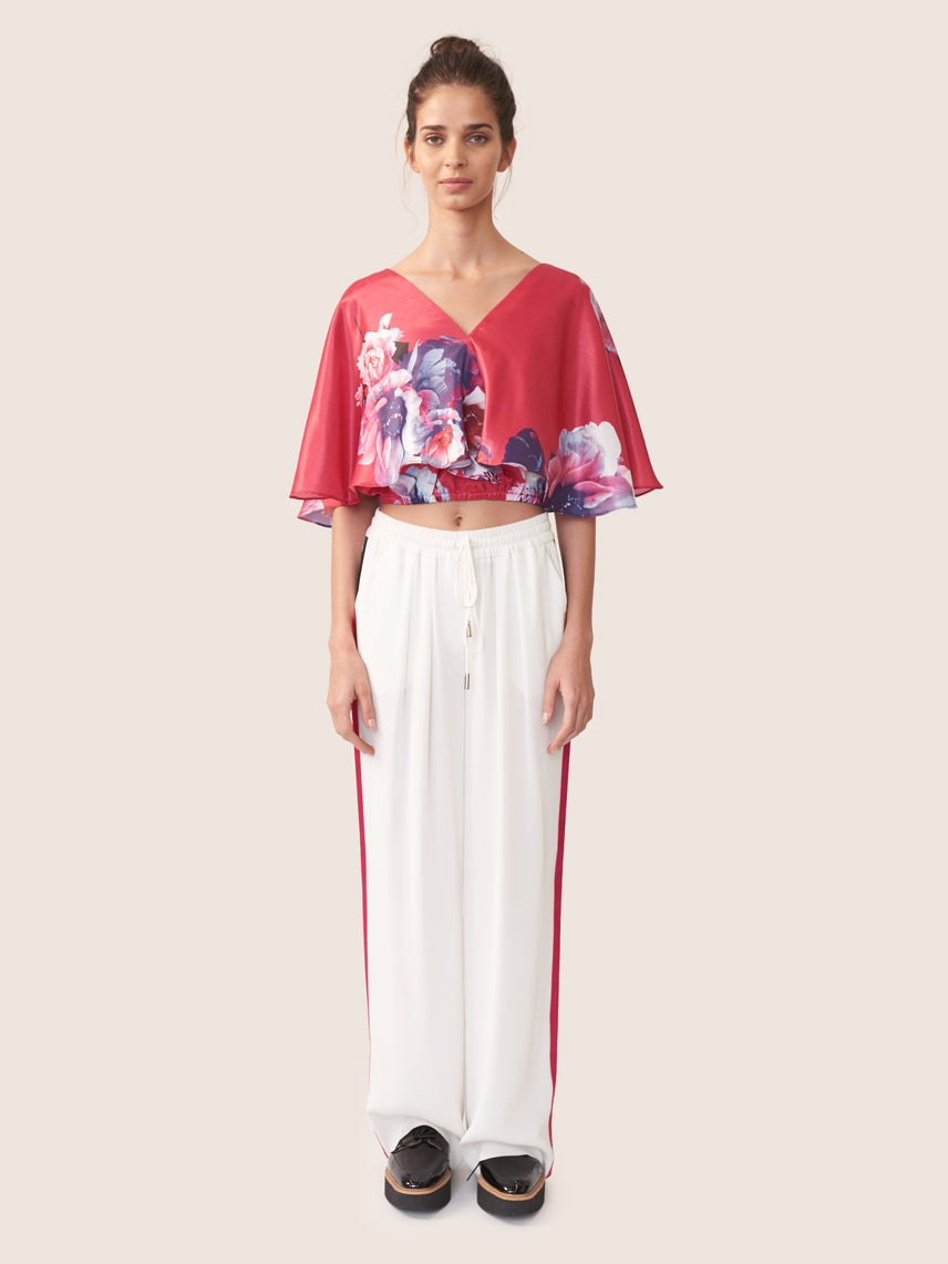 Floral print cropped blouse with layered capelet overlay and exposed cross tie back Alternate