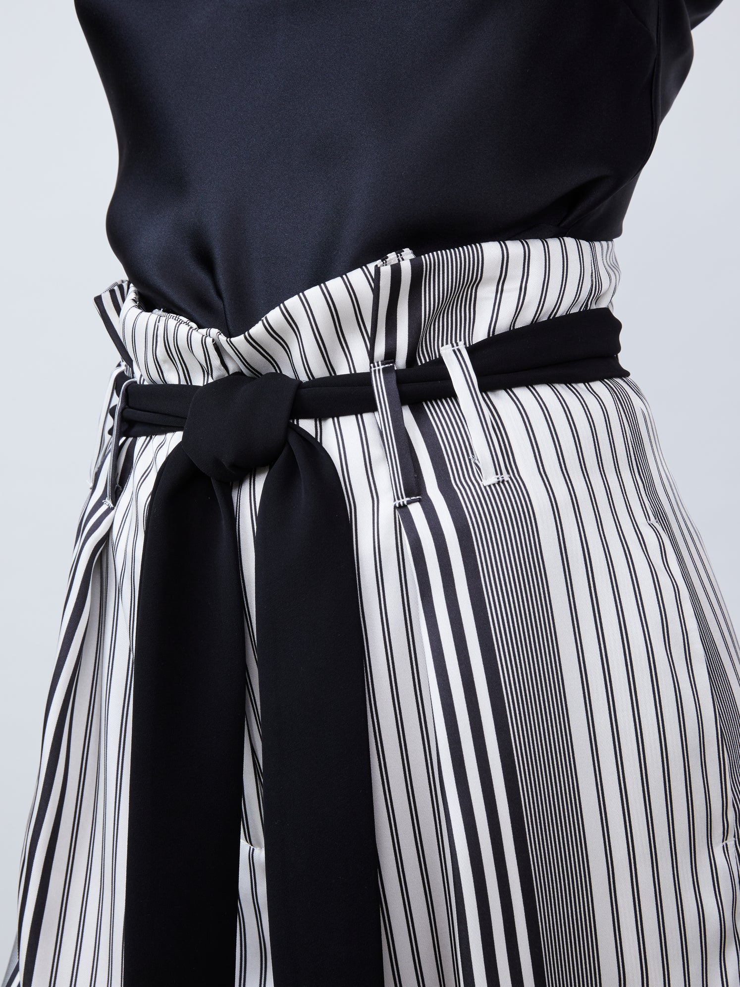 Striped wide-leg pant with paperbag waist and black ribbon tie belt