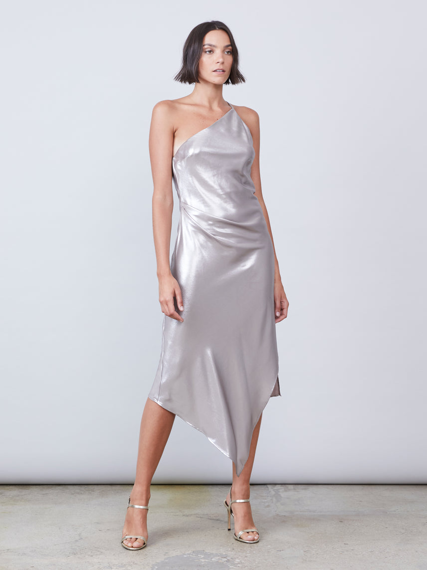 One shoulder asymmetrical slip dress in platinum lamé featuring a front leg slit