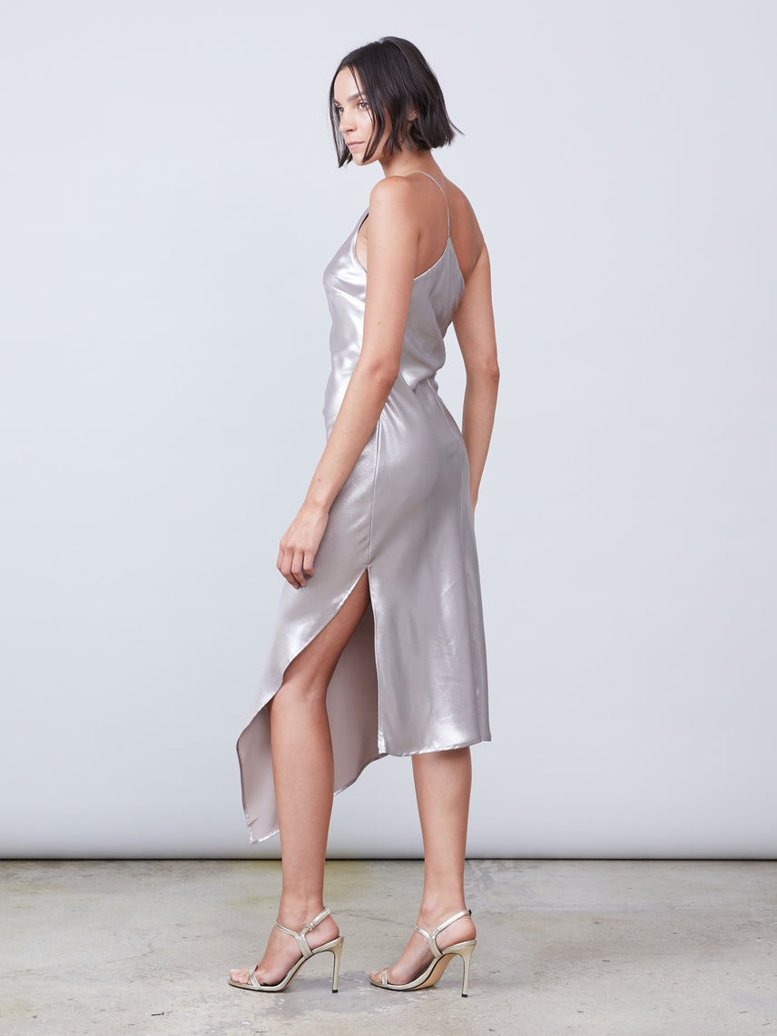 One shoulder asymmetrical slip dress in platinum lamé featuring a front leg slit Alternate